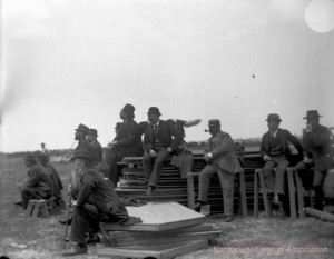 Photo of men sitting on building materials, 1893 Memorial Day