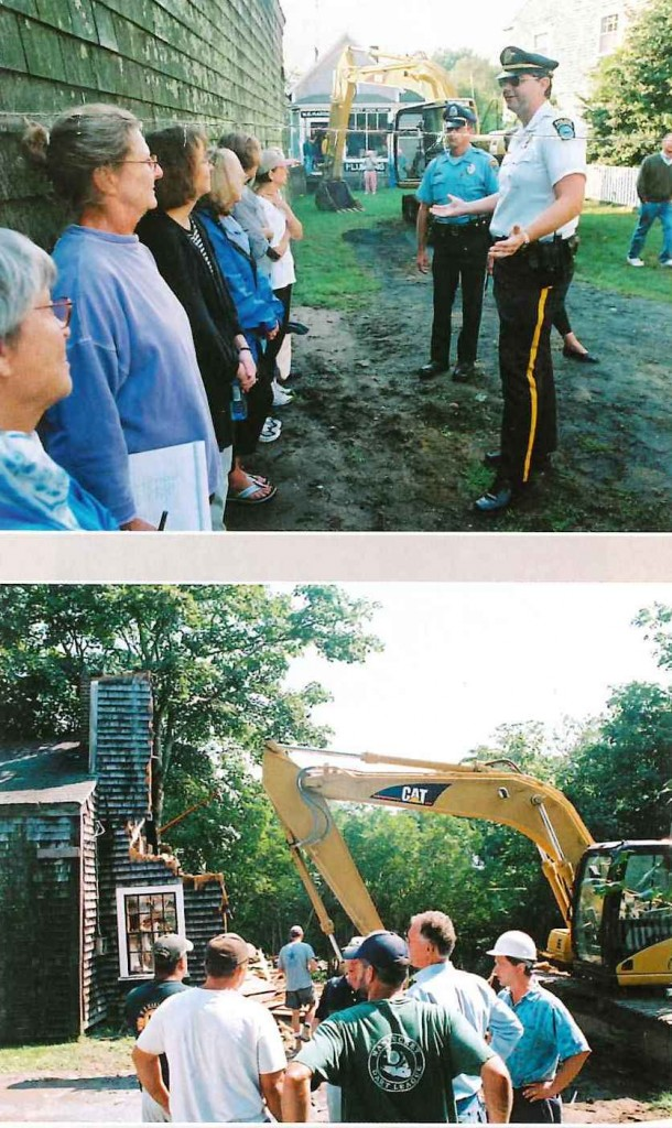 A photo in 2001 of island preservationists attempting to stop demolish of 106 Main Street